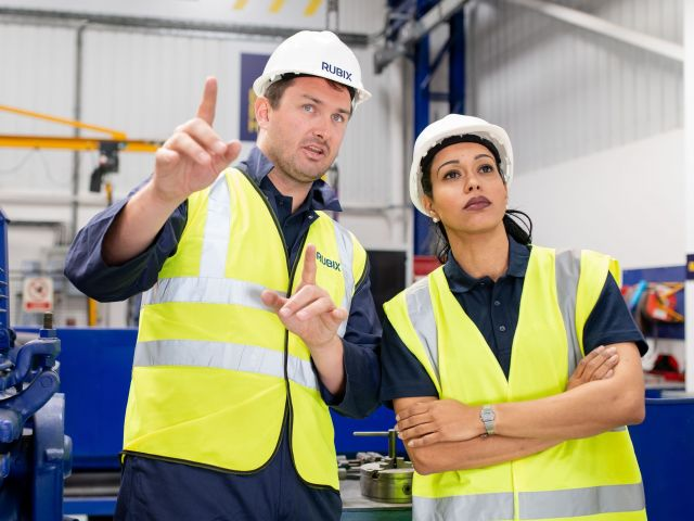 UK_engineering centre_one man one woman_PPE_advise